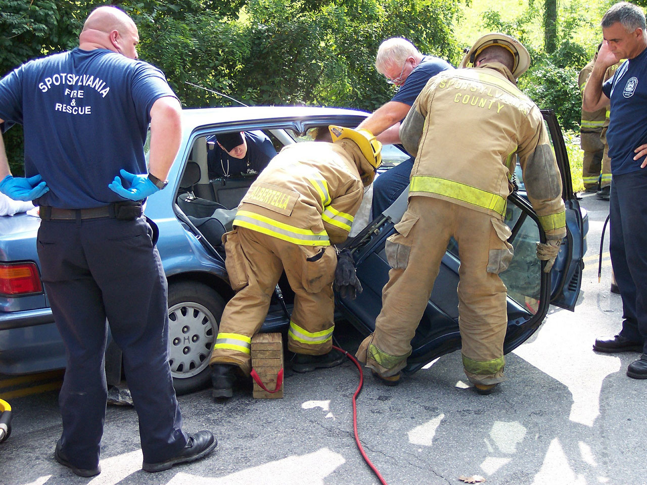 Firefighters rescuing someone from a personal injury car accident.